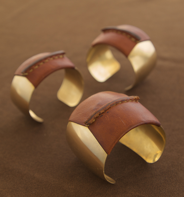 domed brass and leather cuffs